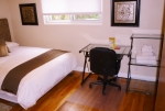 Guestroom 2 includes queensize bed, custom  headboard, desk, dresser, large closet bed and bath linens and decor